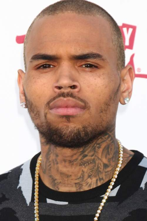 chris brown bald new haircut