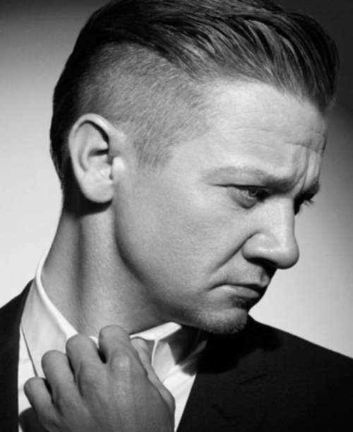jeremy renner slicked back hairstyle side fade haircut
