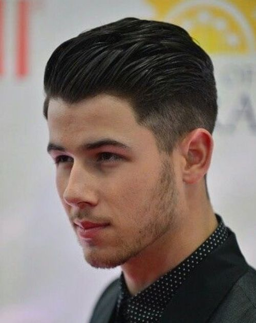 2 nick jonas slicked back high textured hairstyle with side part short