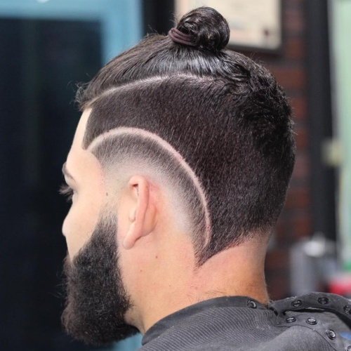 high razor cut low fade haircut with man bun hairstyle