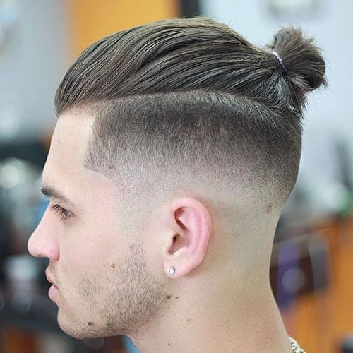 long hair man bun fade side slicked back undercut