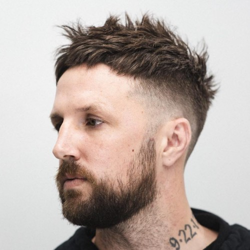 spiky short hairstyle with beard and burst fade haircut
